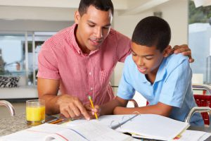 parent helping teen with homework